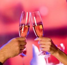 couple clinking champagne over dinner (Small)